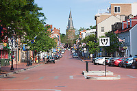 A view up Main Street to the spire of St. Anne's Episcopal Church in Annapolis, Maryland.