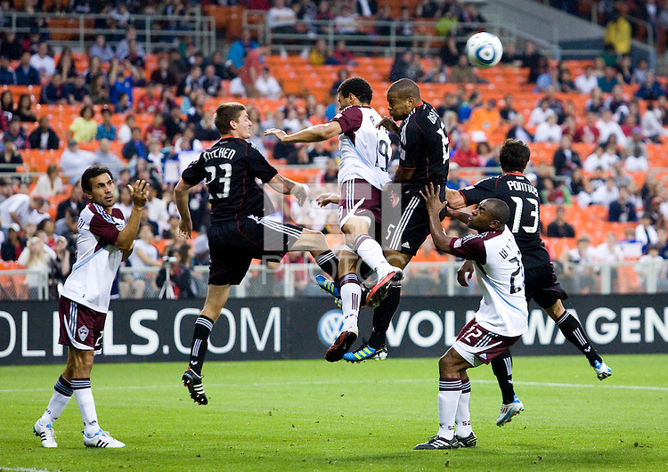 Perry Kitchen (23), Ethan White (15), and Chris Pontius (13) of D.C. United go up for a header in the box with Pablo Mastroeni (25), Andre Akpan (19), and Marvell Wynne (22) of the Colorado Rapids during the game at RFK Stadium in Washington, DC.  D.C. United tied the Colorado Rapids, 1-1.