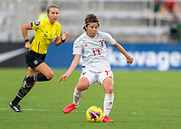 ORLANDO, FL - MARCH 05: Narumi Miura #17 of Japan passes the ball during a game between Spain and Japan at Exploria Stadium on March 05, 2020 in Orlando, Florida.
