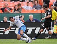 San Jose EarthQuakes midfielder Ramiro Corrales (12) gets fouled by DC United midfielder Chris Pontius (13)  The San Jose Earthquakes defeated DC United 2-1 at RFK Stadium, Sunday September 27, 2009.