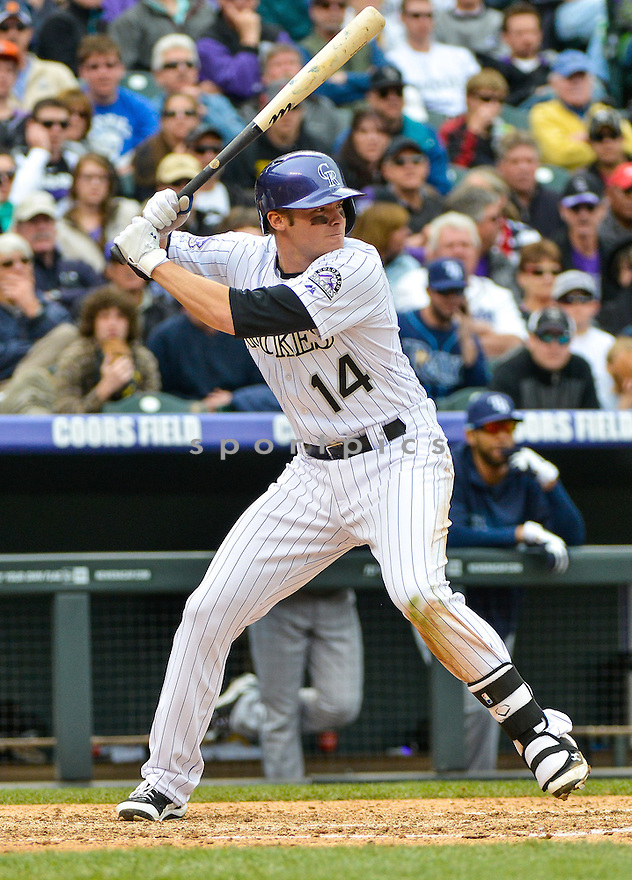 Colorado Rockies Josh Rutledge (14) during a game against the Tampa Bay Rays on May 5, 2013 at Coors Field in Denver, CO. The Rays beat the Rockies 8-3..