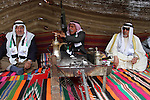 Palestinian men gather in a tent to mark Land Day on March 30, 2016, in Khan Yunis, in the southern Gaza Strip, as Palestinians mark Land Day. March 30 marks Land Day, the annual commemorations of the killing by police of six Arab citizens in 1976 during protests against land confiscations in northern Israel's Galilee region. Photo by Abed Rahim Khatib
