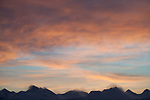 View of Chugach Mountains sunrise with wind whipping the mountaintops