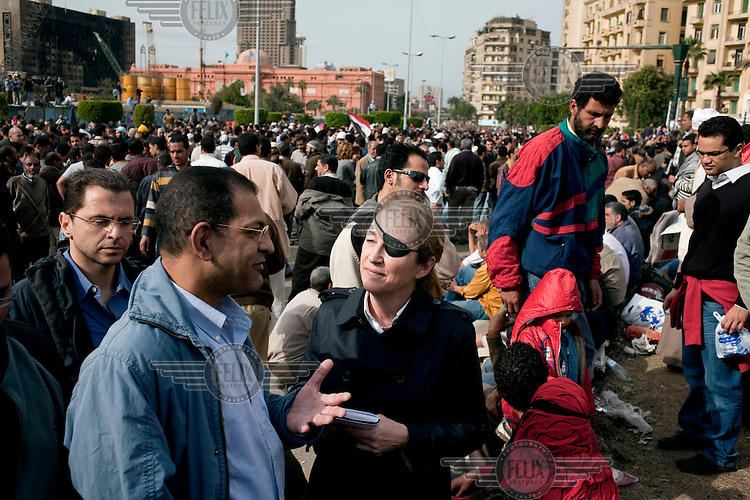 Journalist Marie Colvin talking to a protester in Tahrir square, the scene of heavy clashes between pro and anti government protesters. Continued anti-government protests take place in Cairo calling for President Mubarak to stand down. After dissolving the government and allowing for talks with opposition parties Mubarak still refuses to step down from power.
