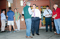 Republican presidential candidate and New Jersey governor Chris Christie greets people after speaking to a crowd at the Salt Hill Pub in Hanover, New Hampshire.