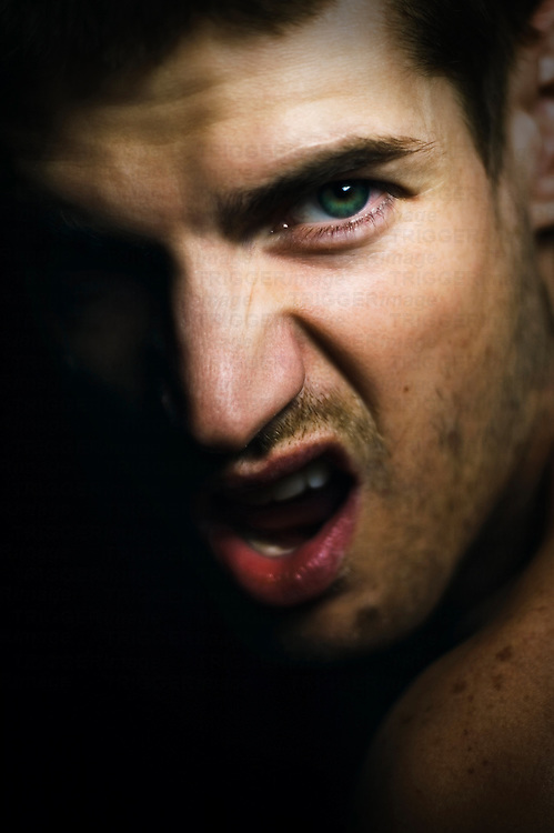 Close up of a young man's face being angry