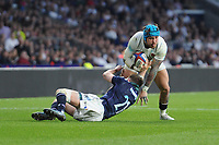 Jack Nowell of England is tackle Henry Pyrgos of Scotland by during the RBS 6 Nations match between England and Scotland at Twickenham Stadium on Saturday 11th March 2017 (Photo by Rob Munro/Stewart Communications)