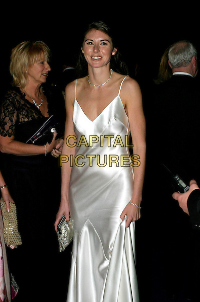 JOOLS OLIVER.Leaving The National Television Awards 2005 at the Royal Albert Hall, London, UK..October 25th, 2005.Ref: AH.half length silver metallic silk satin dress Jooles Jules.www.capitalpictures.com.sales@capitalpictures.com.© Capital Pictures.