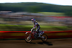 Zackary Lundy (322) competes on the course at the Unadilla Valley Sports Center in New Berlin, New York on July 16, 2006, during the AMA Toyota Motocross Championship.