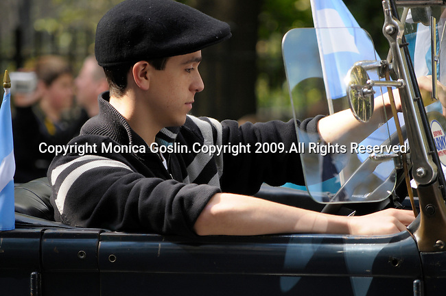 The Hispanic Parade in New York City. A boy drives an antique car and represents Argentina in the Hispanic Parade in New York City.