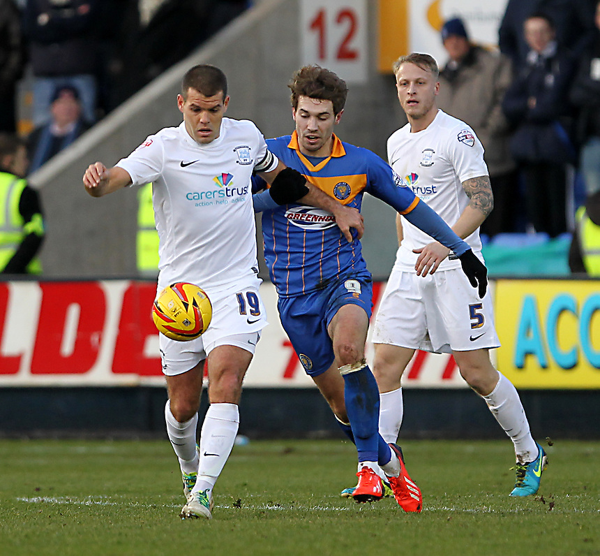 Preston North End's John Welsh battles with  Shrewsbury Town's Tom Bradshaw<br /><br />Photo by Mick Walker/CameraSport<br /><br />Football - The Football League Sky Bet League One - Shrewsbury Town v Preston North End - Sunday 29th December 2013 - Greenhous Meadow - Shrewsbury<br /><br />&copy; CameraSport - 43 Linden Ave. Countesthorpe. Leicester. England. LE8 5PG - Tel: +44 (0) 116 277 4147 - admin@camerasport.com - www.camerasport.com