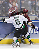 Bert Lenz looks on as Zach Jones and Chris Collins battle along the boards - The Boston College Eagles defeated the University of North Dakota Fighting Sioux 6-5 on Thursday, April 6, 2006, in the 2006 Frozen Four afternoon Semi-Final at the Bradley Center in Milwaukee, Wisconsin.