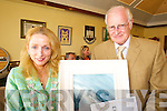 CIVIC AWARD: Former journalist, Seamus McConville, receives a special civic award on behalf of Tralee Town Council from Mayor Miriam McGillycuddy on Friday.   Copyright Kerry's Eye 2008
