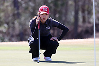 WALLACE, NC - MARCH 09: Zhangcheng Guo of Boston University lines up a putt on the 12th hole of the River Course at River Landing Country Club on March 09, 2020 in Wallace, North Carolina.