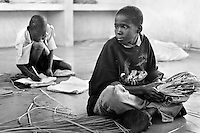 Children go to school in a day-care centre in Maputo, Mozambique on February 25, 2001. More than 13 million African children have been orphaned by the AIDS pandemic. Worldwide, more than 20 million people have died since 1981.