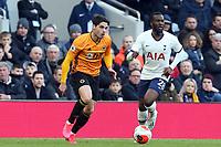 Raul Jimenez of Wolverhampton Wanderers and Tanguy NDombele of Tottenham Hotspur during Tottenham Hotspur vs Wolverhampton Wanderers, Premier League Football at Tottenham Hotspur Stadium on 1st March 2020
