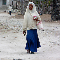 Jambiani, Zanzibar, Tanzania.  Muslim Schoolgirl Walking to School.
