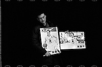 Player Liu Zeshi of Tsinghua University Affiliated Middle School basketball team displays pictures of himself competing at last year's China High School Basketball League before a training session at Tsinghua University Affiliated Middle School in Beijing, January 2012.