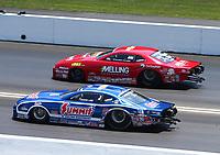 Jun 17, 2018; Bristol, TN, USA; NHRA pro stock driver Jason Line (near) races alongside Erica Enders during the Thunder Valley Nationals at Bristol Dragway. Mandatory Credit: Mark J. Rebilas-USA TODAY Sports