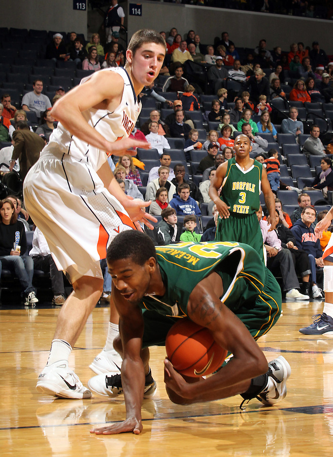 Dec. 20, 2010; Charlottesville, VA, USA; Norfolk State Spartans guard/forward Chris McEachin (35) dives after a loose ball in front of Virginia Cavaliers guard Joe Harris (12) during the game at the John Paul Jones Arena. Mandatory Credit: Andrew Shurtleff