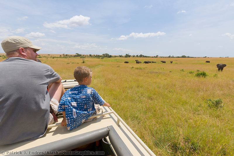 Tourists watch elephants in the Masa Mara, Kenya, East Africa
