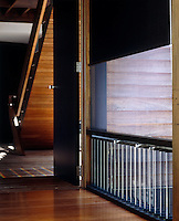 Louvered windows and blinds are used in the house as an energy-efficcient way of controlling the temperature