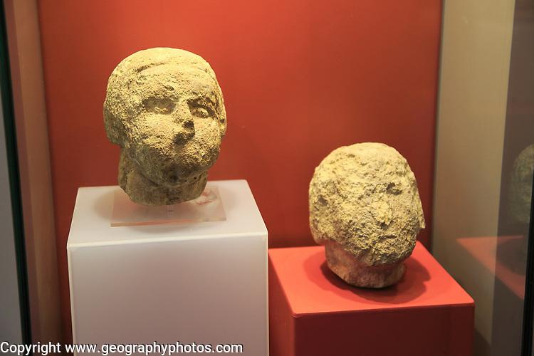 Ggantija temples visitor centre display museum, Gozo, Malta stone human heads faces
