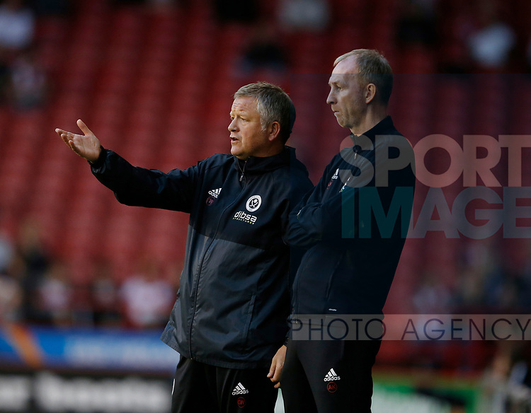 Chris Wilder manager of Sheffield Utd and assistant Alan Knill during the Carabao Cup, second round match at Bramall Lane, Sheffield. Picture date 22nd August 2017. Picture credit should read: Simon Bellis/Sportimage