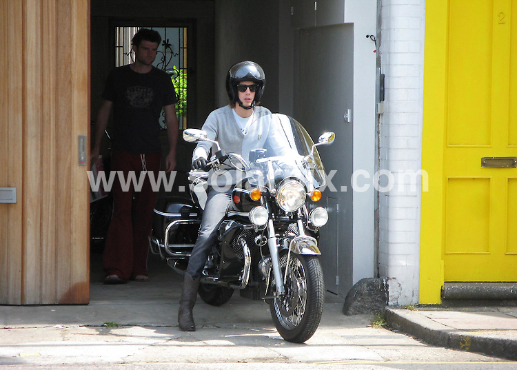**ALL ROUND EXCLUSIVE PICTURES FROM SOLARPIX.COM**.**WORLDWIDE SYNDICATION RIGHTS**.Johnny Borrell looked a little uneasy when he took his new Moto Guzzi out for a spin this week. After passing his motorcycle test only six weeks ago in London's Edgware Rd, the Razorlight front-man was desperately trying to brush  up on his riding skills, before hopefully convincing Hollywood girlfriend Kirsten Dunst to ride pillion. Go Johnny, Go!!.JOB REF: 4096    MSR    DATE: 19.06.07.**MUST CREDIT SOLARPIX.COM OR DOUBLE FEE WILL BE CHARGED* *UNDER NO CIRCUMSTANCES IS THIS IMAGE TO BE REPRODUCED FOR ANY ONLINE EDITION WITHOUT PRIOR PERMISSION*