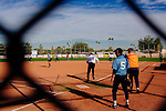 Two of the 31 softball teams in Sun City play on the fields near the Sun Bowl in Sun City, Arizona December 3, 2013. Sun City, Arizona was the first age-restricted city of retirees when it opened in 1960.