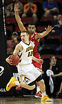Iowa's Mike Gesell (10) looks to pass off while being guarded by   Davidson's Jack Gibbs (12) during 2015 NCAA Division I Men's Basketball Championship March 20, 2015 at the Key Arena in Seattle, Washington.  Iowa beat Davidson 83-52.   ©2015. Jim Bryant Photo. ALL RIGHTS RESERVED.