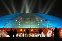 The National Grand Theatre designed by French architect Paul Andreu, beside the Great Hall of the People in Beijing, China..