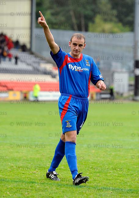 Grant Munro celebrates his winning penalty kick