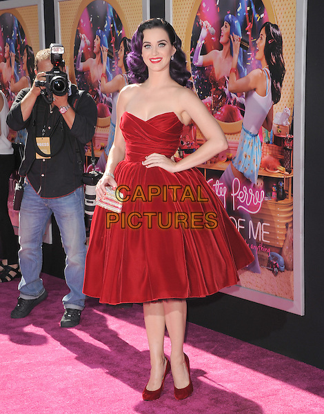 """Katy Perry.""""Katy Perry: Part Of Me"""" Los Angeles Premiere held at Grauman's Chinese Theatre, Hollywood, California, USA..June 26th, 2012.full length red strapless velvet dress  dyed purple hair hand on hip silver clutch bag                                  .CAP/RKE/DVS.©DVS/RockinExposures/Capital Pictures."""
