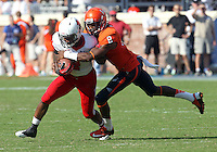Virginia safety Anthony Harris (8) tackles Ball State running back Horactio Banks (4) Ball State defeated Virginia 48-27 during an NCAA football game Saturday Oct. 5, 2013 at Scott Stadium in Charlottesville, VA. Photo/Andrew Shurtleff