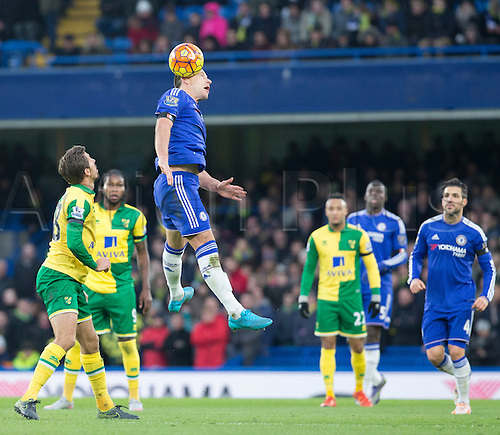 21.11.2015. Stamford Bridge, London, England. Barclays Premier League. Chelsea versus Norwich City. Chelsea defender John Terry heads the ball away from the Chelsea  goal area.