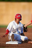 Auburn Doubledays catcher Luis Vilorio (4) slides into third during a game against the Williamsport Crosscutters on June 25, 2016 at Falcon Park in Auburn, New York.  Auburn defeated Williamsport 5-4.  (Mike Janes/Four Seam Images)