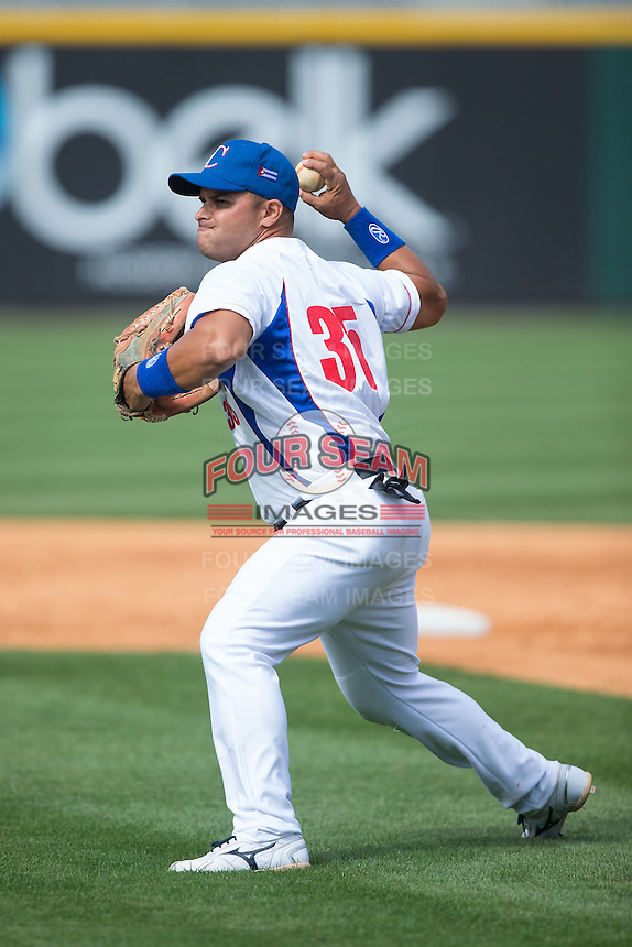 Yorbis Borroto Jauregui (35) of the Cuban National Team takes infield practice prior to the game against the US Collegiate National Team at BB&T BallPark on July 4, 2015 in Charlotte, North Carolina.  The United State Collegiate National Team defeated the Cuban National Team 11-1.  (Brian Westerholt/Four Seam Images)