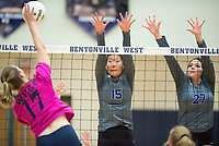 NWA Democrat-Gazette/CHARLIE KAIJO Rogers High School opposite hitter Allie Stephens (15) and middle blocker Alex Parish (27) block during the girl's volleyball game on Thursday, October 12, 2017 at Bentonville West High School in Centerton.