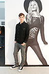 Model poses in Hudson jeans next to large poster at the Coterie 2013 trade show presented by ENK International, at the Javits Center on September 18, 2013.