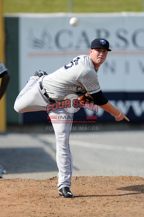 Mobile BayBears starting pitcher Archie Bradley #25 warms up in the bullpen before a game against the Tennessee Smokies at Smokies Park on August 25, 2013 in Kodak, Tennessee. The BayBears won the game 2-0. (Tony Farlow/Four Seam Images)