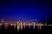The Chicago skyline with Lake Michigan in the foreground.
