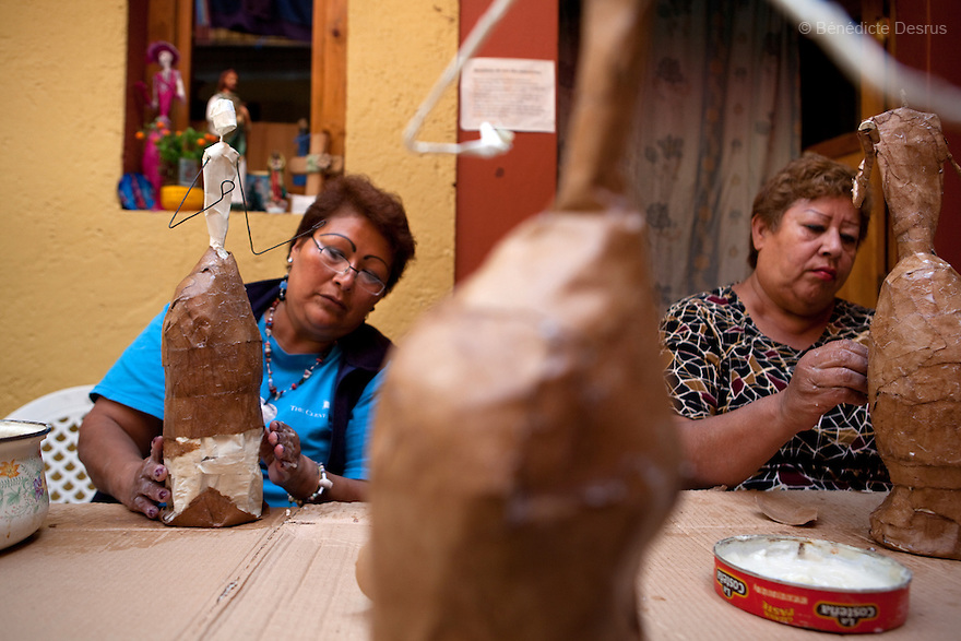 Paola (L) and Lourdes (R), both residents of Casa Xochiquetzal, make catrinas to sell and make money to support the shelter in Mexico City, Mexico on October 7, 2010. Catrinas are popular figures used during the Day of the Dead celebrations in Mexico. Casa Xochiquetzal is a shelter for elderly sex workers in Mexico City. It gives the women refuge, food, health services, a space to learn about their human rights and courses to help them rediscover their self-confidence and deal with traumatic aspects of their lives. Casa Xochiquetzal provides a space to age with dignity for a group of vulnerable women who are often invisible to society at large. It is the only such shelter existing in Latin America. Photo by Bénédicte Desrus