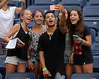 FLUSHING NY- AUGUST 26: Jordan Fisher takes a selfie with fans during rehearsals for Arthur Ashe kids day at the USTA Billie Jean King National Tennis Center on August 26, 2016 in Flushing Queens. Photo byMPI04 / MediaPunch