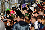 Grimsby Town fans wave their wigs during the Vanamara Conference League match between Woking and Grimsby Town at the Kingfield Stadium, Woking, Surrey<br /> Picture by David Horn/eXtreme aperture photography +44 7545 970036<br /> 07/03/2015