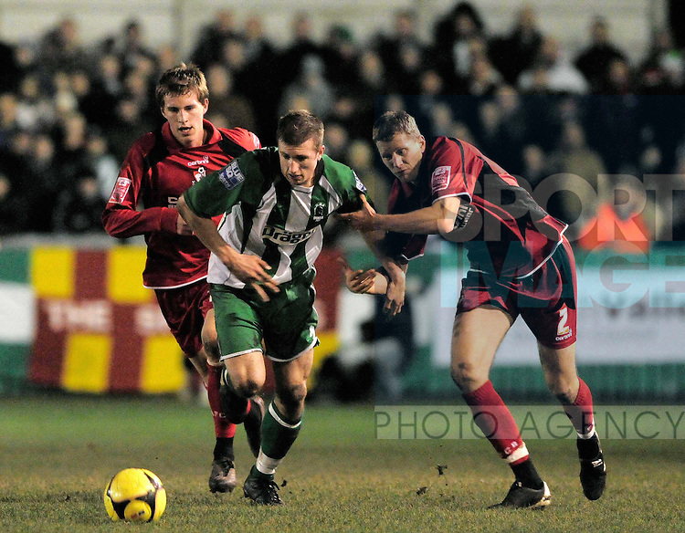 Blyth's Anthony Hulme and Bournemouth's Scott Guyett (far right) and Joe Partington.
