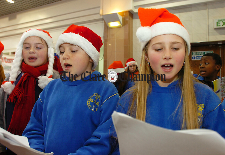 L-R Rebecca Kennedy (11), Lisa Green (11) and Clodagh Burke(11) CBS Christmas Carol singing at Dunnes Mall in aid of St Josephs Hospital.Pic Arthur Ellis.