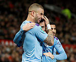 Kyle Walker of Manchester City squeezes scorer Bernardo Silva of Manchester City to celebrate the first goal during the Carabao Cup match at Old Trafford, Manchester. Picture date: 7th January 2020. Picture credit should read: Darren Staples/Sportimage
