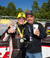 May 7, 2017; Commerce, GA, USA; NHRA top fuel driver Steve Torrence (left) celebrates with photographer Gary Nastase after winning the Southern Nationals at Atlanta Dragway. Mandatory Credit: Mark J. Rebilas-USA TODAY Sports