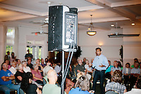 """A speaker stands at the edge of the crowd as Republican presidential candidate Bobby Jindal speaks to people gathered at his """"Believe Again"""" campaign event at the Governor's Inn and Restaurant in Rochester, New Hampshire. Jindal is campaigning in New Hampshire in advance of the 2016 Republican presidential primary there."""